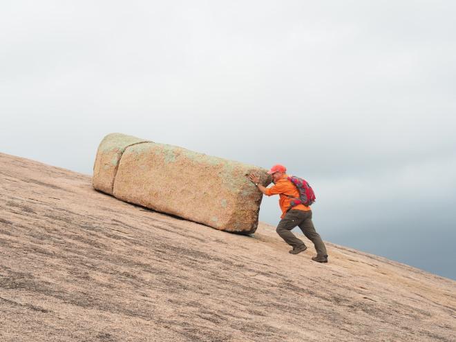 Omar Pushing Rock Enchanted Rock